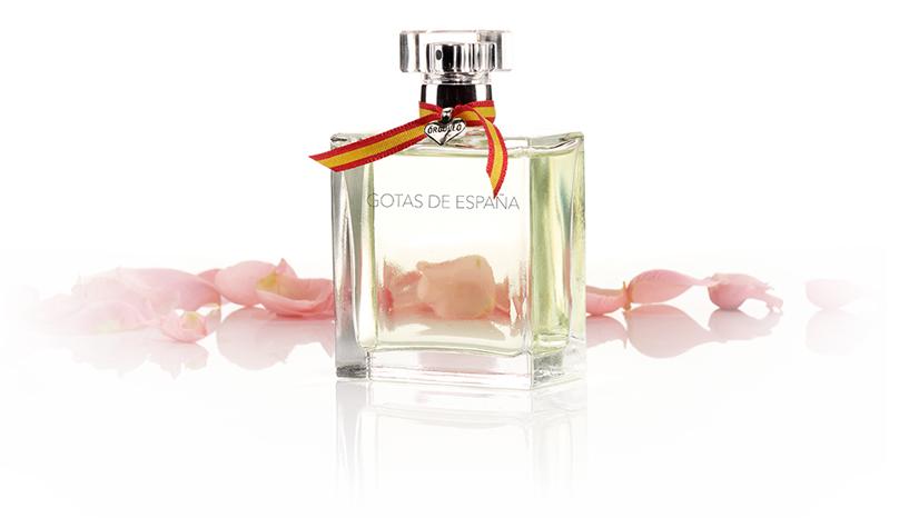 Frasco de perfume Gotas de España con pétalos